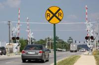 car at a Four-quadrant Gates sign