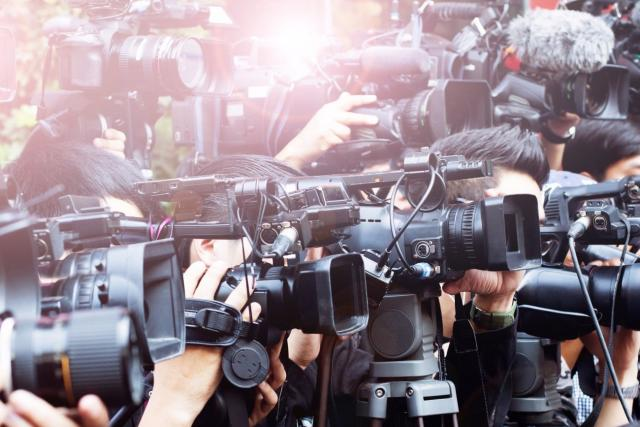 a photo of news media cameras