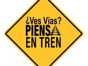 a yellow sign logo with spanish slogan