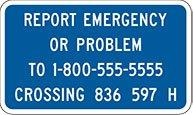 an image of a blue and white railroad crossing emergency notification system sign