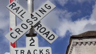 photo of a railroad crossing sign