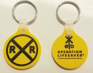 yellow keychain with OLI logo